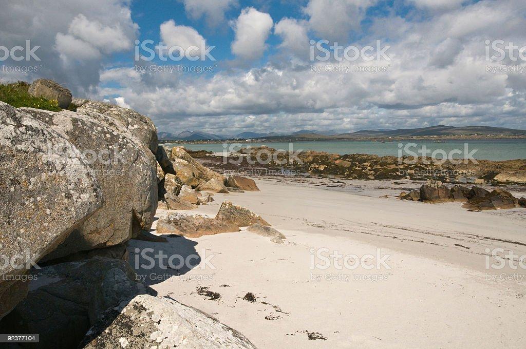 Sand beach with rocks royalty-free stock photo
