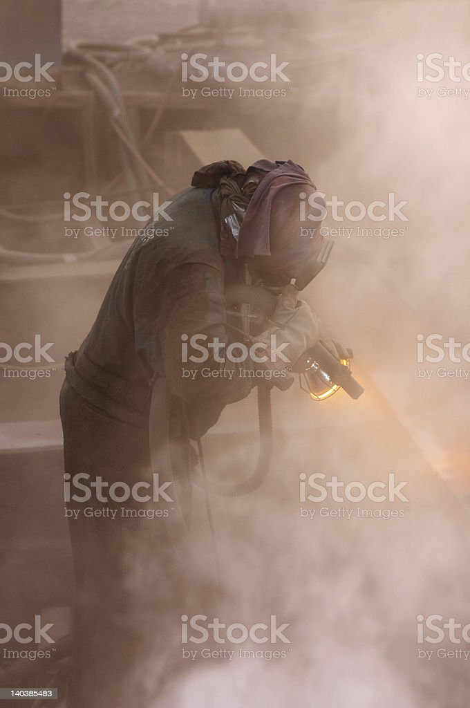 sand blasting at dusk stock photo