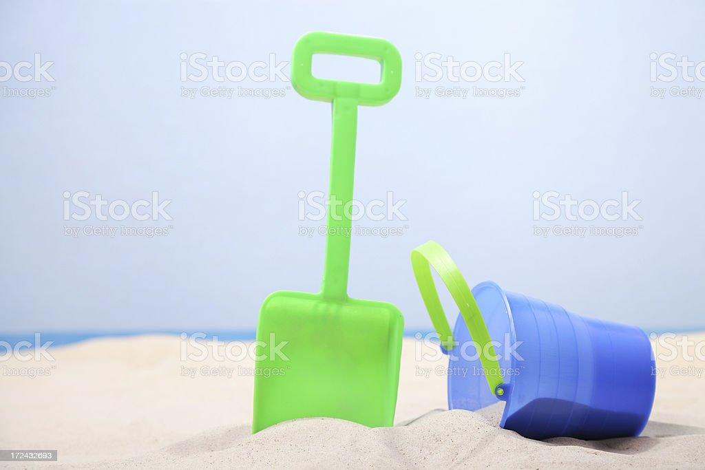 Sand bucket and shovel on white beach royalty-free stock photo