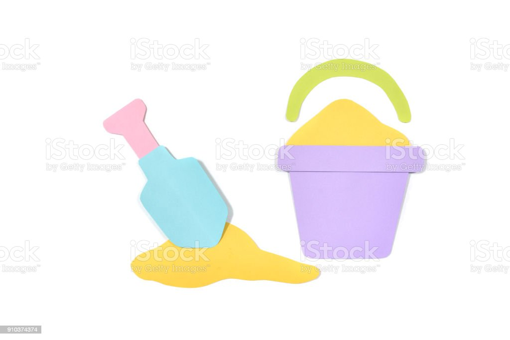 Sand bucket and shovel paper cut on white background stock photo
