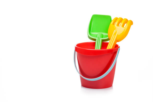 Sand bucket, pail and shovel isolated on reflective white background stock photo