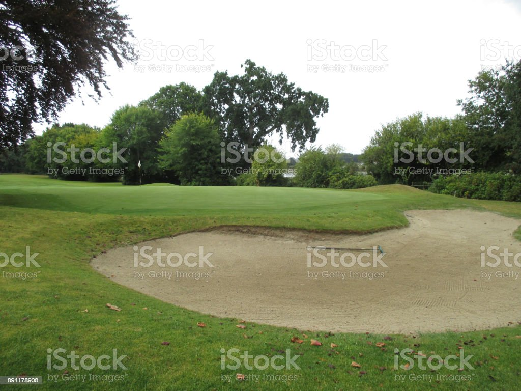 Sand bunker near a green on a golf course stock photo