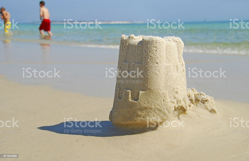 Sand Castle and Children Playing royalty-free stock photo