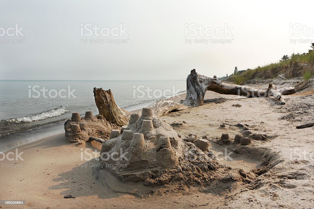 Sand Castle and Driftwood on a Lake Huron Beach stock photo