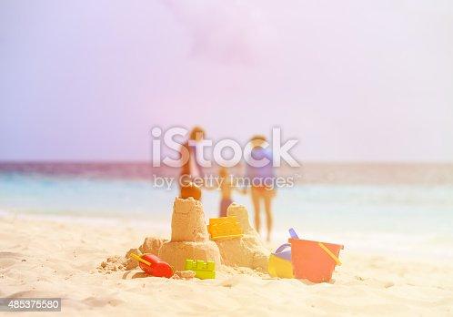 512726470 istock photo sand castle and toys on tropical beach 485375580