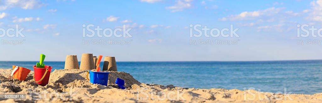 Sand castle on the beach stock photo