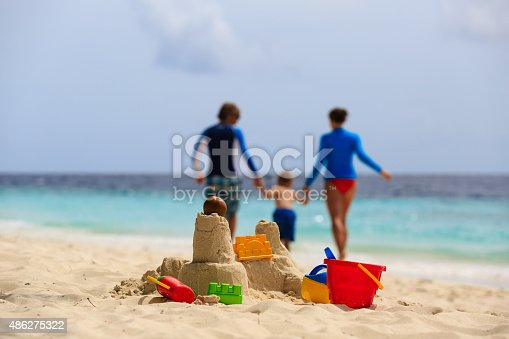 512726470 istock photo sand castle on tropical beach, family vacation 486275322