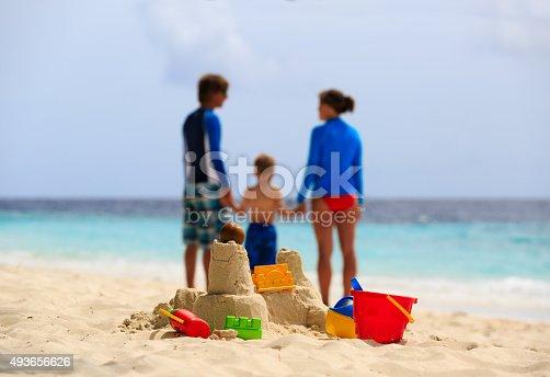 512726470 istock photo sand castle on tropical beach, family vacation 493656626