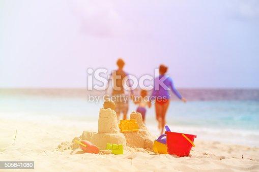 512726470 istock photo sand castle on tropical beach, family vacation 505841080