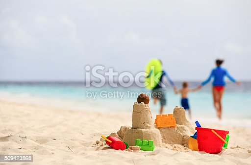 istock sand castle on tropical beach, family vacation 509423868