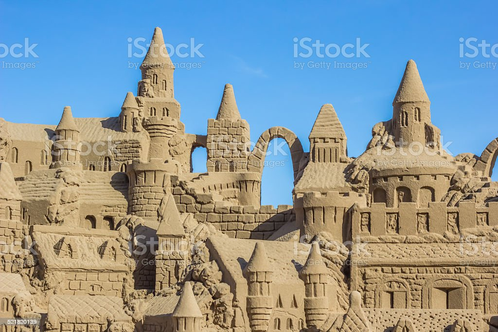 Sand castle with several towers stock photo