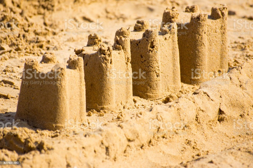 Sand castles at dusk stock photo