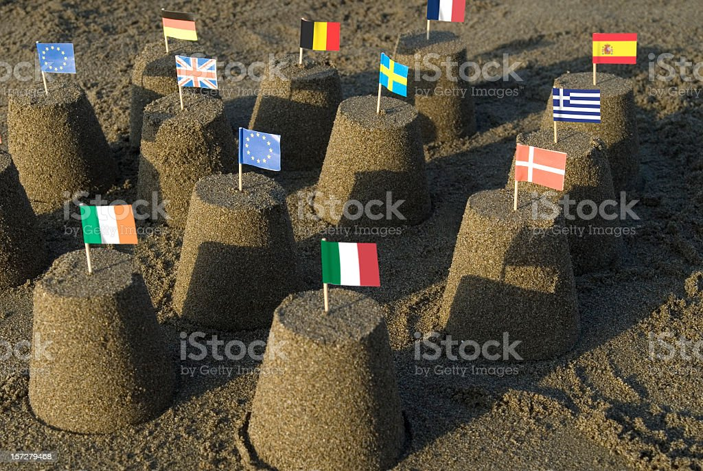 Sand castles with tooth pick flags of the European Union stock photo