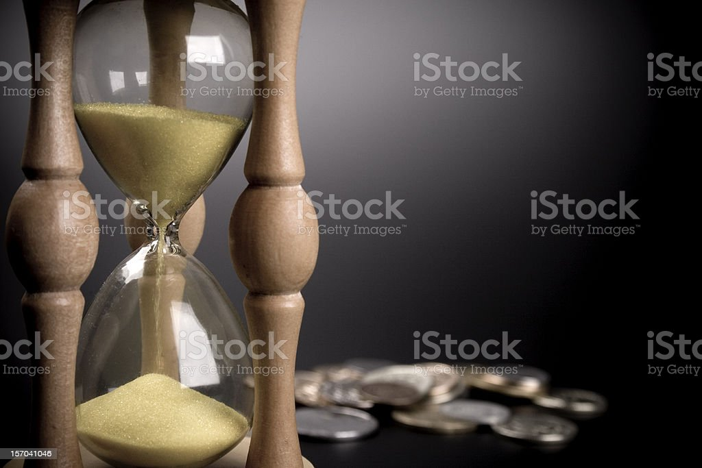 sand clock and coins royalty-free stock photo