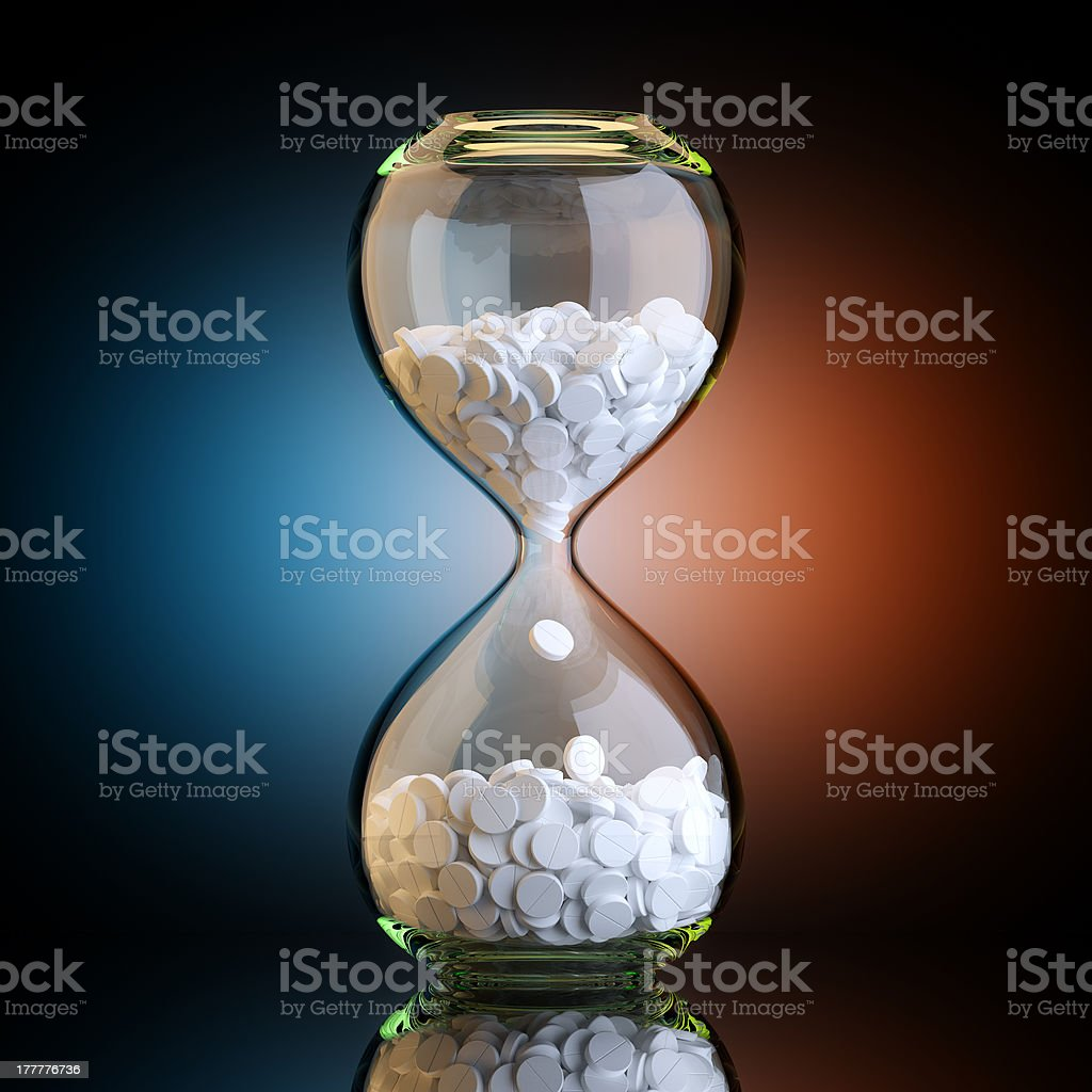Sand Clock With Pills In Black Studio Artistic Backlight royalty-free stock photo