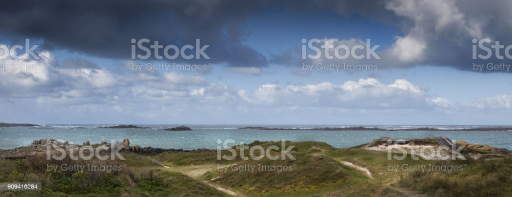 Sand covered German bunker  part of the Atlantic Wall, Brittany, France. stock photo