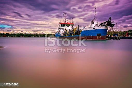 Sand dredger in dock at Lakes Entrance in East Gippsland