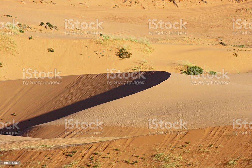 Sand dune at sunset stock photo