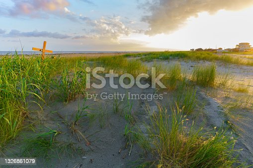 istock A sand dune marked with a cross to memorialize the victims of Hurricane Rita that flattened the villiage in 2005 1326861079