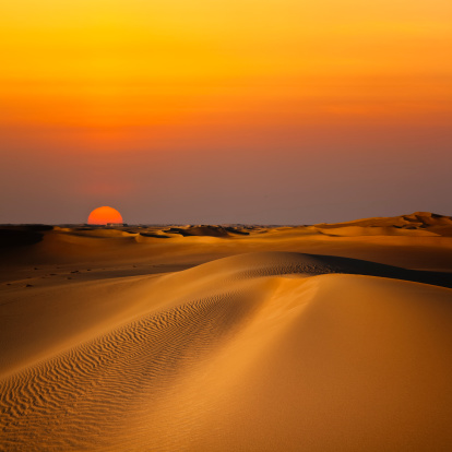 Sunset in the sand dunes near the oasis of Siwa (Egypt)