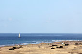 sand dunes and sailing boat at Grand Canary Island Spain