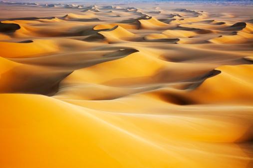 Sand dunes at sunrise in White Desert, Egypt.