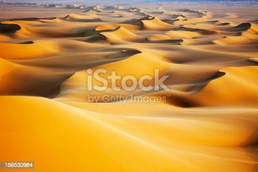Sand dunes at sunrise in White Desert, Egypt.