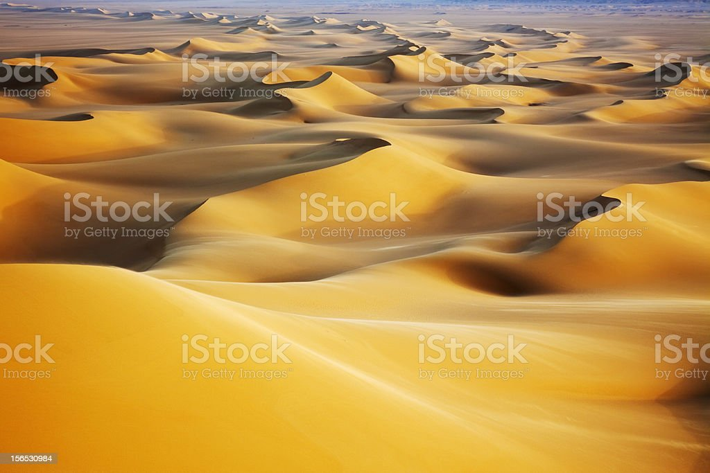 Sand dunes at sunrise stock photo