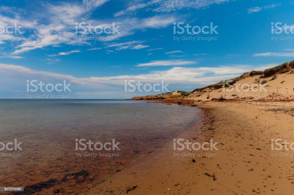 Sand dunes beach and clear water on a sunny day at Cavendish, Prince Edward Island stock photo