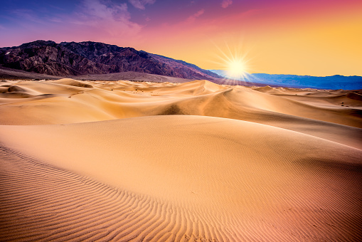 Death Valley, California sand dunes with colorful sunset