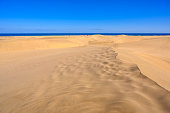 Sand Dunes in Gran Canaria with beautiful coast and beach at Maspalomas, Canarian Islands, Spain