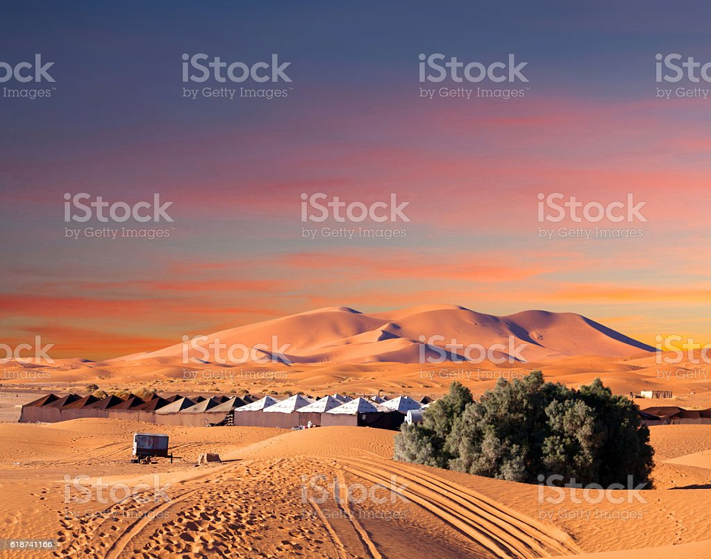Sand dunes in Sahara desert in Africa Camp site over sand dunes in Merzouga, Sahara desert, Morocco, Africa Adventure Stock Photo
