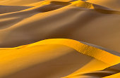 Dunes in the sahara, merzouga morocco. Golden desert dunes. Hills of the sahara. Evening in the desert. Lanscape morocco. Scenic view