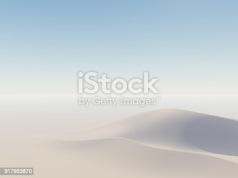 Sand dunes on horizon with light from side.