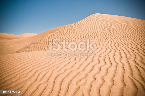 Textured sand lines in the desert.