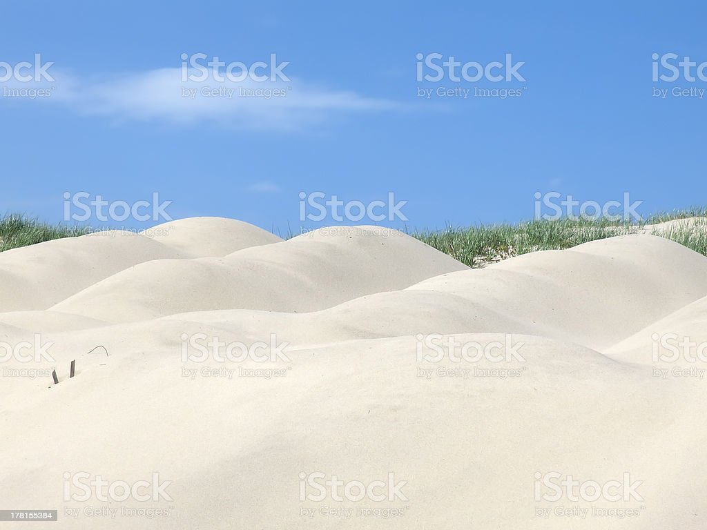 Sand dunes rounded by the wind royalty-free stock photo