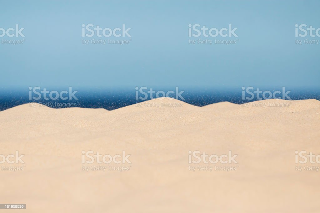 Sand dunes with flying sand, background with copy space royalty-free stock photo