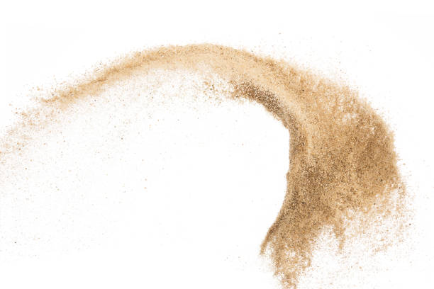 Sand flying explosion isolated on white background ,throwing freeze stop motion object design stock photo