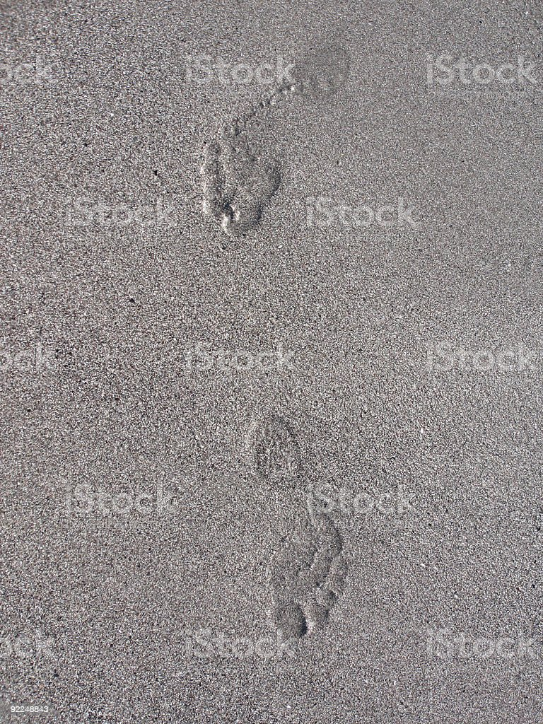 Sand footsteps stock photo