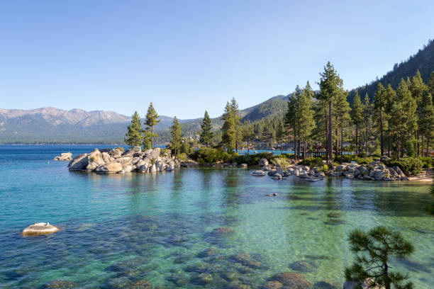 Sand Harbor at Lake Tahoe Lake Tahoe is a freshwater alpine lake located in the Sierra Nevada bay of water stock pictures, royalty-free photos & images