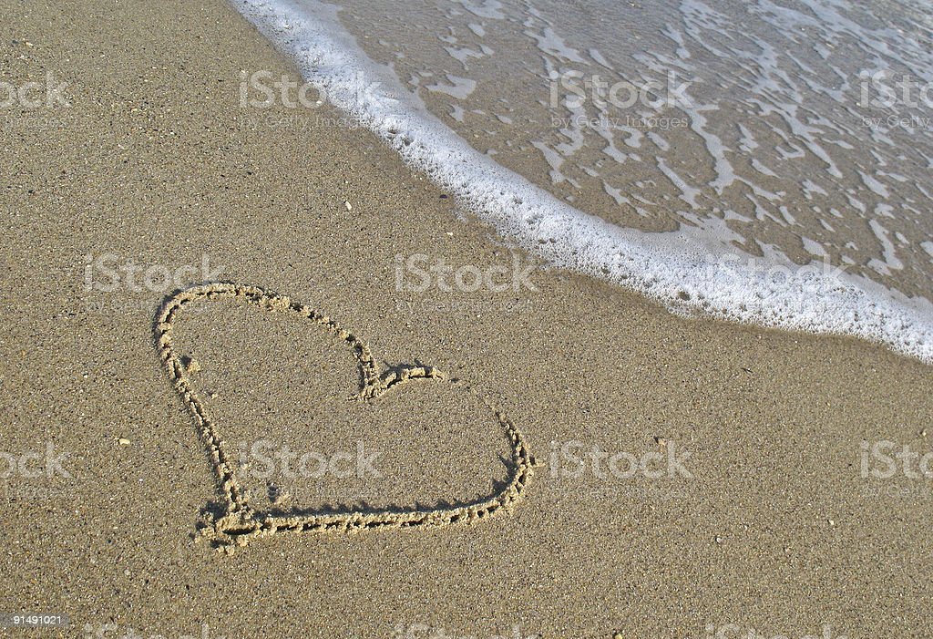 Sand heart at the seabeach royalty-free stock photo