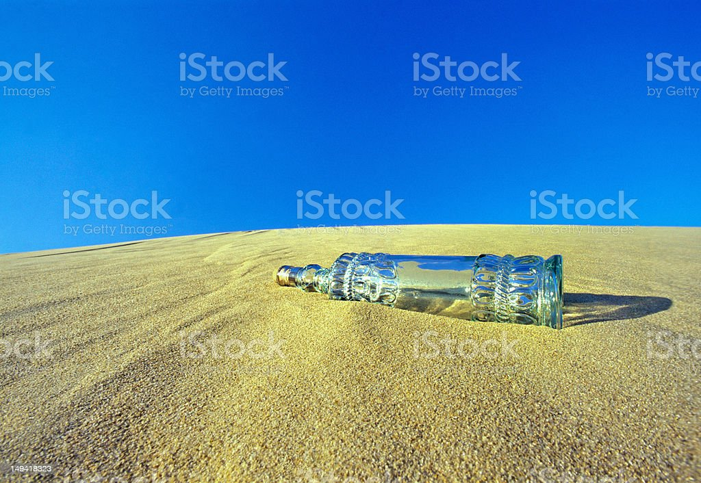 Sand hill and a Bottle royalty-free stock photo