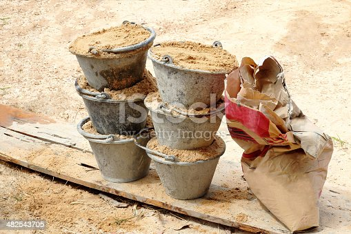 istock Sand in bucket for cement mixing 482543705