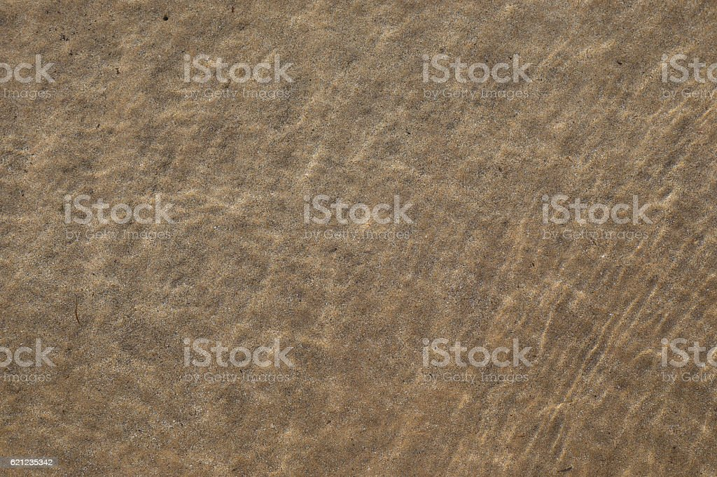 Sand in shallow sea stock photo