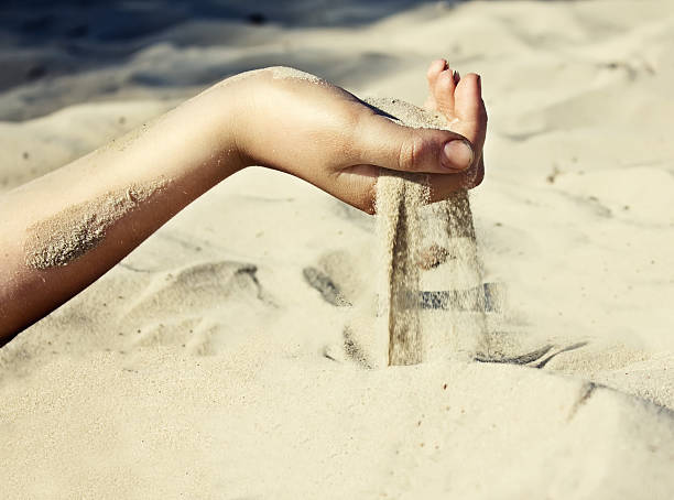 sand-is-pouring-through-his-fingers-pict
