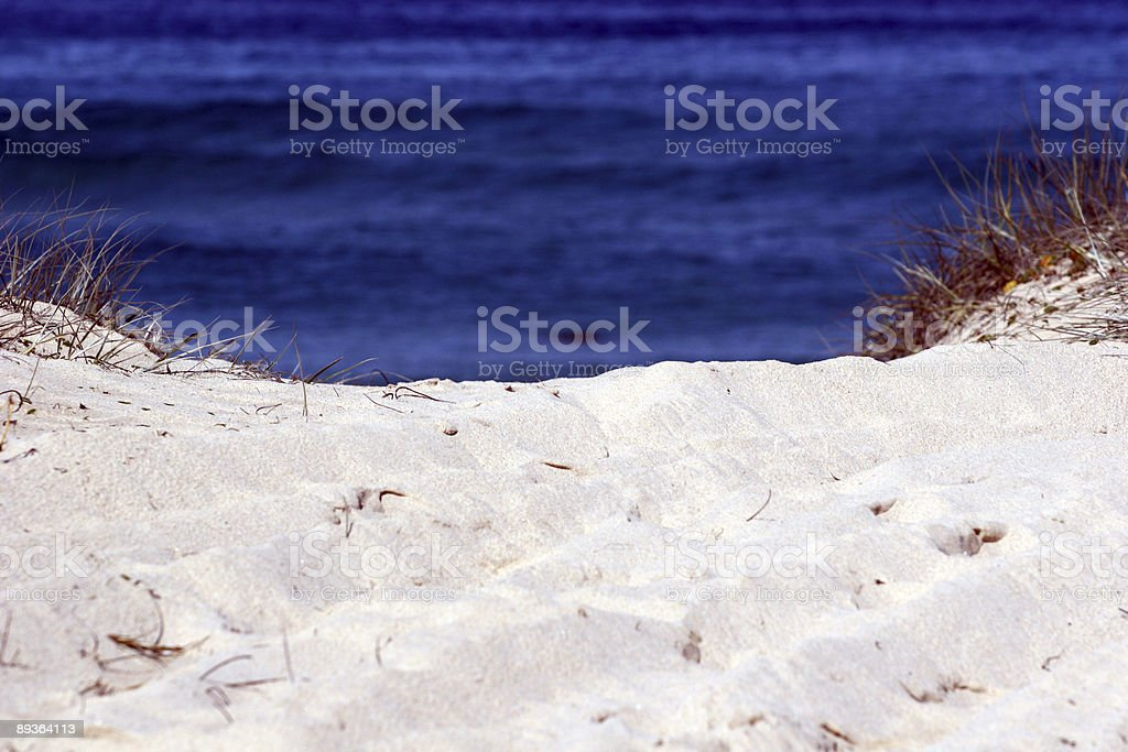 Sand meets the sea royalty-free stock photo