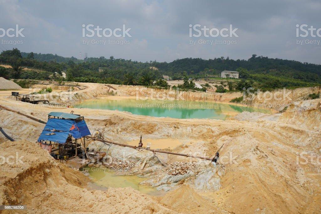 sand mine operation after deforestation stock photo
