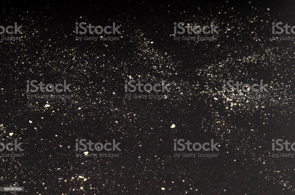 Sand on a black background stock photo