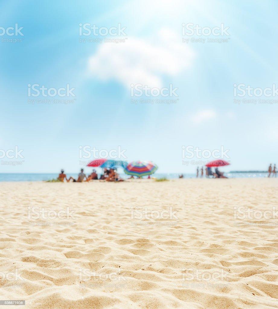 sand on beach closeup and sun in blue  sky stock photo
