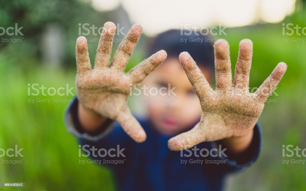 Sand on hands. stock photo
